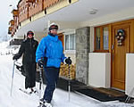 Two skiers at Chalet Morzine front door
