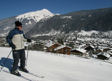 Skier on piste looking down at Chalet Morzine