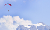 Paragliding above mountains