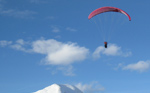 Paragliding above snow-capped mountain