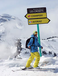 Skier at France-Switzerland signpost