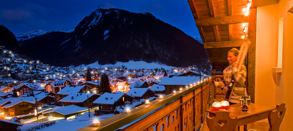 Twinkling lights of Morzine from chalet balcony