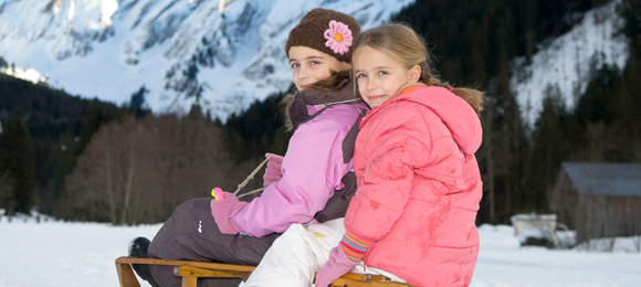 Two girls on a sledge