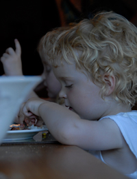 Young child eating at table